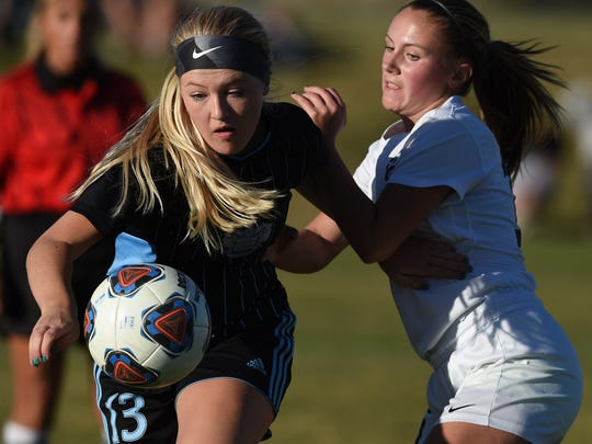 Reed's Grace Newlin, left, looks to beat Galena's Peyton Kosman to the ball in Monday Regional playoff game at Galena high on Oct. 30,.