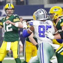 Rodgers right at home on road in postseason