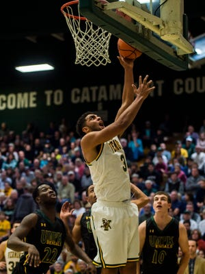 UVM's Anthony Lamb goes up for two during their men's basketball match up at Patrick Gym against the University of Main Fort Kent Wednesday night, Nov. 22, 2017.