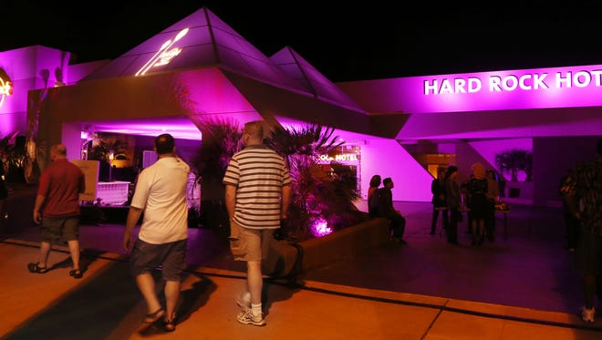 The exterior of the Hard Rock Hotel Palm Springs is bathed in purplish light during an invitation only opening night party at the former Zoso Hotel in downtown Palm Springs,Thursday, October 3, 2013. Michael Snyder/The Desert Sun