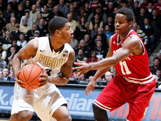 Purdue Boilermakers guard Ronnie Johnson (3) is guarded by Indiana Hoosiers guard Yogi Ferrell (11) at Mackey Arena.