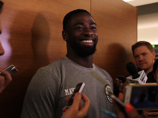 NY Jets draft pick Marcus Maye being interviewed in the locker room during Jets Rookie Camp.