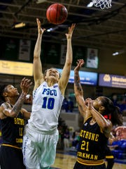 FGCU's Tayler Goodall grabs the rebound away from Bethune-Cookman's