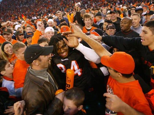 Oregon State's Steven Jackson celebrates with fans
