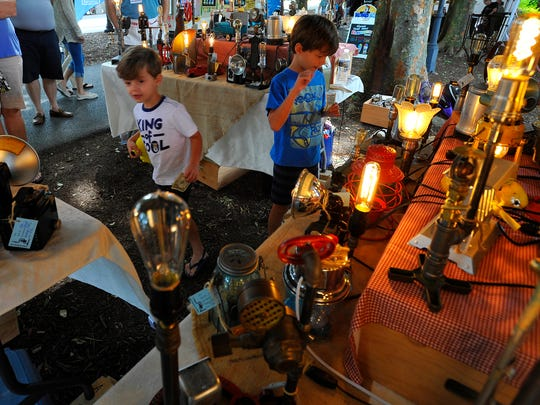 Lincoln Brandstedter, 4, and brother Clayton, 7, check out lamps made from re-purposed materials at the Lamps from the Attic booth at the YorkFest Fine Arts Festival, Sunday, August 27, 2017. John A. Pavoncello photo