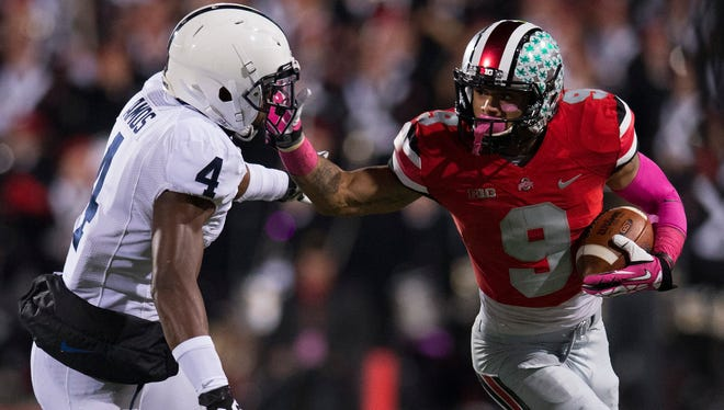 Ohio State wide receiver Devin Smith (9) fends off Penn State safety Adrian Amos (4) in a 63-14 Buckeyes win Saturday at Ohio Stadium.