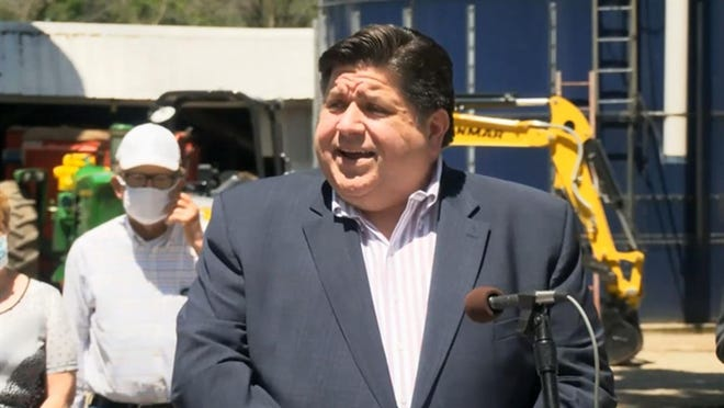 Gov. JB Pritzker speaks in Geneseo Wednesday to announce the awarding of $50 million in grants to 28 projects aimed at expanding broadband internet access across the state.