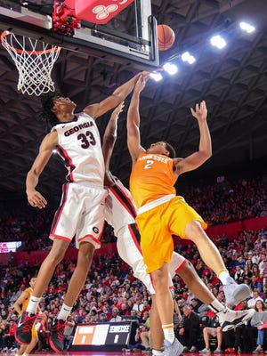 Georgia forwards Nicolas Claxton (33) and Yante Maten (1) block a shot by Tennessee forward Grant Williams (2) during the first half Saturday.
