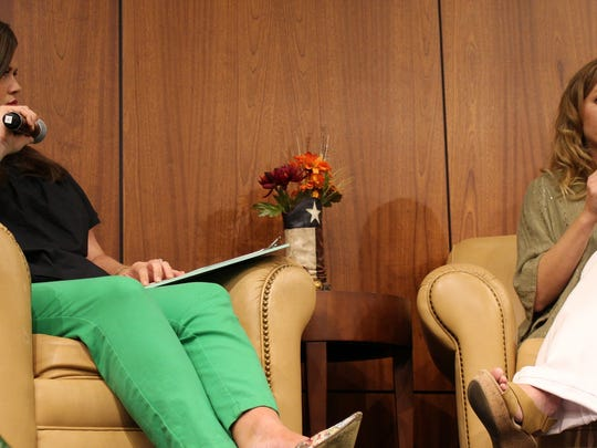 """All comfy in soft chairs, cookbook author Tiffany Harelik, right, answers questions posed by Trish Dressen, of the Abilene Convention & Visitors Bureau, at Thursday's Boots & Books Culinary Luncheon. The meal was based on recipes found in Harelick's """"Big Country Cookbook."""""""