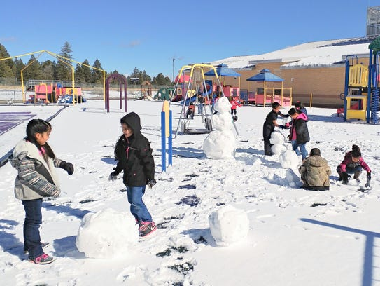The storm was brief but left enough snow behind for first grade fun at the Mescalero School.