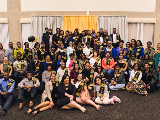 UWM Class of 2017 graduates wear their Kente stoles at the African American Graduation Reception on May 5th, 2017. The reception celebrated students' accomplishments and honored each of them with a Kente stole made of traditional African fabric.