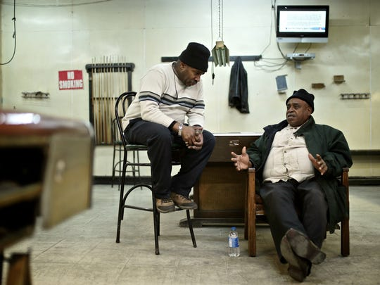 Tony Bean, left, 64, of Detroit, the owner of Bill's Recreation, talks with long time patron Edward Moore, 77, of Detroit, on Friday, February 5, 2016, in Detroit.