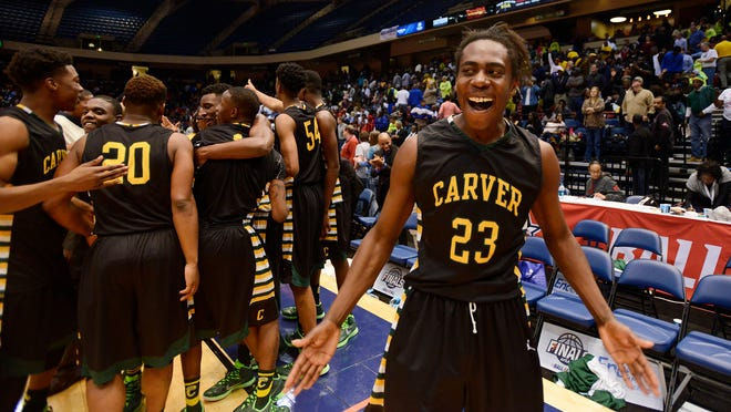 G.W. Carver's Brandon Austin celebrates winning the 6A state championship game at the in Legacy Arena at the Birmingham-Jefferson Civic Center on Saturday.
