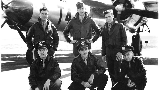 World War II veteran Cyrus Kirk (lower left) is pictured with members of his Army Air Corps squad.