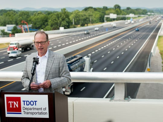 TDOT Commissioner John Schroer speaks during the ribbon-cutting ceremony for the Peytonsville Road bridge over Interstate 65 on June 15, 2016, in Franklin.
