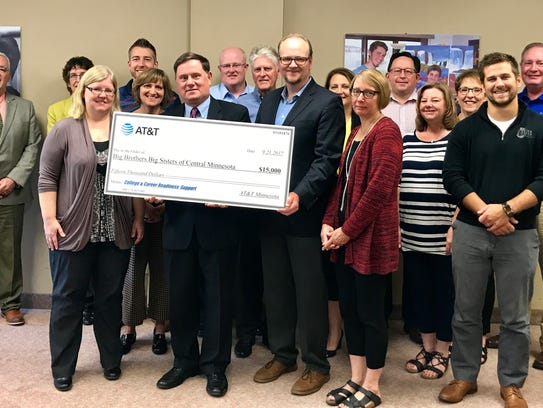 AT&T presents a $15,000 AT&T donation to Big Brothers
