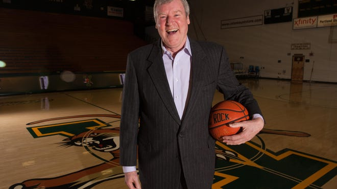 Tom Brennan, the former University of Vermont men's basketball coach, poses for a portrait in 2015.