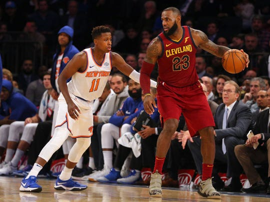 Cleveland Cavaliers small forward LeBron James (23) controls the ball against New York Knicks point guard Frank Ntilikina (11) during the fourth quarter at Madison Square Garden on Nov. 13, 2017.