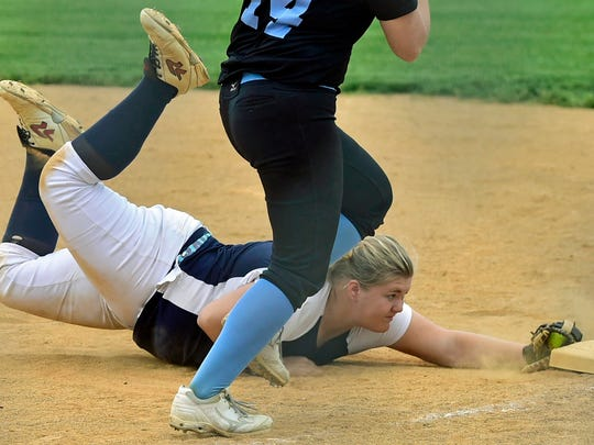 Alicen Hoover of Greencastle lays out to beat Daniel Boone's Caitlin McCrone to first base. Greencastle-Antrim lost to Daniel Boone 2-1 in the first round of the  D-3 playoffs, Tuesday, May 23, 2017.