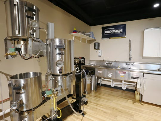 Marcus Mecca uses the kitchen area of Grape, Grain and Bean to teach beer and wine crafting classes. Mecca and his wife, Rachel, have been operating the business since 2005.