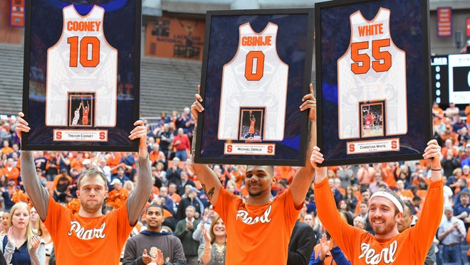 Aquinas graduate Christian White, a backup the past two seasons for the Orange, was honored on Senior Day at the Carrier Dome on Feb. 27 with the Orange's starting backcourt, Trevor Cooney and Michael Gbinije.