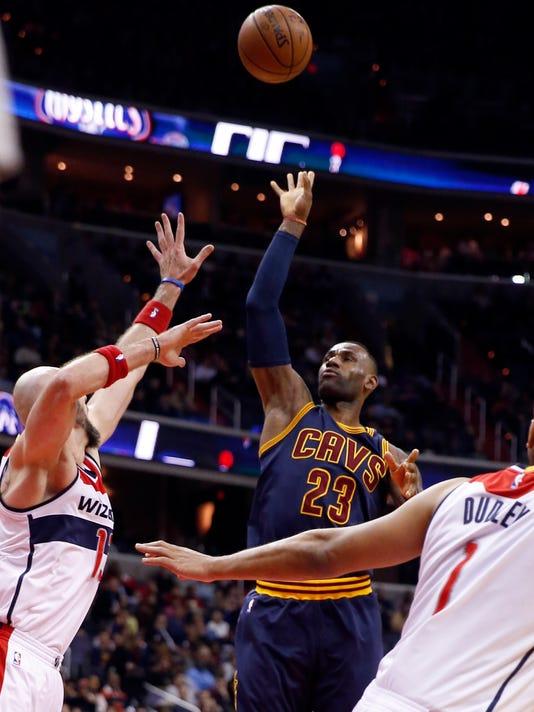 Cleveland Cavaliers forward LeBron James (23) shoots over Washington Wizards center Marcin Gortat, left, during the first half of an NBA basketball game Wednesday, Jan. 6, 2016, in Washington. (AP Photo/Alex Brandon)