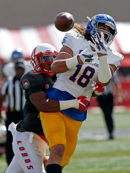San Jose State tight end Billy Freeman (18) misses a reception as he's tackled by New Mexico safety Daniel Henry during the first half of an NCAA college football game in Albuquerque, N.M., Saturday, Oct. 1, 2016. (AP Photo/Andres Leighton)