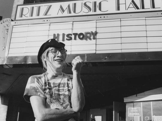 Bill Levin, founder of the First Church of Cannabis in Indianapolis, poses in front of the Ritz Music Hall after it closed its doors in 1991.