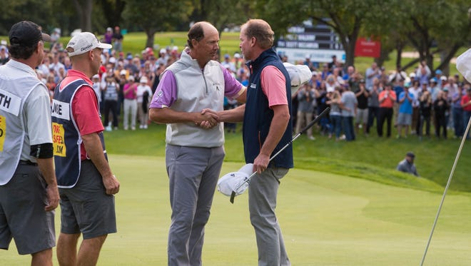 Steve Stricker shakes hands with Jerry Smith after Stricker wins the Sanford International on Sunday, Sept. 23, 2018 in Minnehaha Country Club in Sioux Falls, S.D.