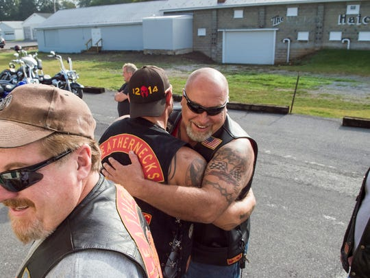 "Scott Seitz greets Tommy ""Beast"" Bittner with a hug outside the American Legion-Post 373 in Greencastle, Pa., before they take part in the 3rd annual Flight 93 Memorial Ride on Saturday. Sept. 10, 2016. Seitz traveled from Boyertown, Pa. to ride with the rest of the group and pay respect to the civilian who sacrificed their lives 15 years ago on Flight 93."