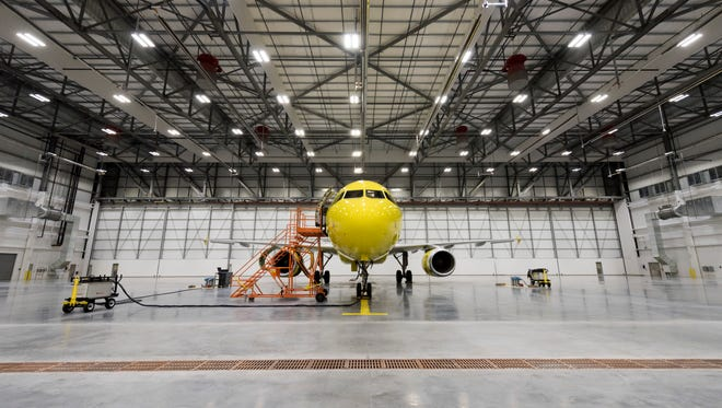 """An A320 """"operational spare"""" airplane sits in the main hangar bay for the new maintenance hangar for Spirit Airlines."""