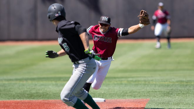 NMSU infielder Nick Gonzales stretches to catch a wide thrown ball from home plate during NMSU verses Chicago State at Presley Askew Field on Saturday.