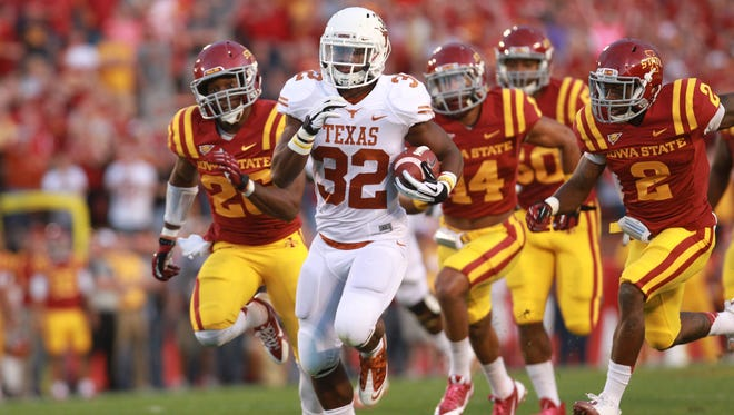 Texas running back Johnathan Gray breaks free from the Iowa State defense for a touchdown in the first quarter.