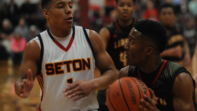 Seton Catholic's Desmond Bane, left, faces off with Liberty Christian's Franklin Nunn Friday night at Earlham College.