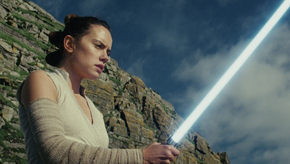 "Rey (Daisy Ridley) and her lightsaber in ""Star Wars:"