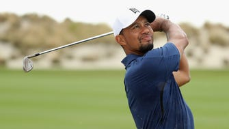 Tiger Woods hits his third shot on the third hole during Round 2 of the Hero World Challenge.