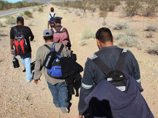 Undocumented Mexican immigrants walk through the Sonoran