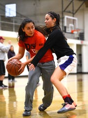 Mia Pulido (right) shows she isn't just a top scorer as she guards Felicia Magana during a recent Santa Paula High practice.