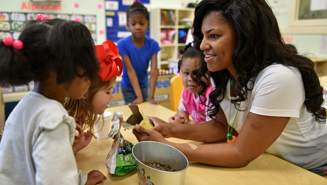 Teacher Tierra Lewis talks with her students at Lake Village Learning Center in Flowood about how to grow plants. The center is getting help from Mississippi Building Blocks, a state-funded program designed to assist licensed child care centers to improve the school readiness of children.