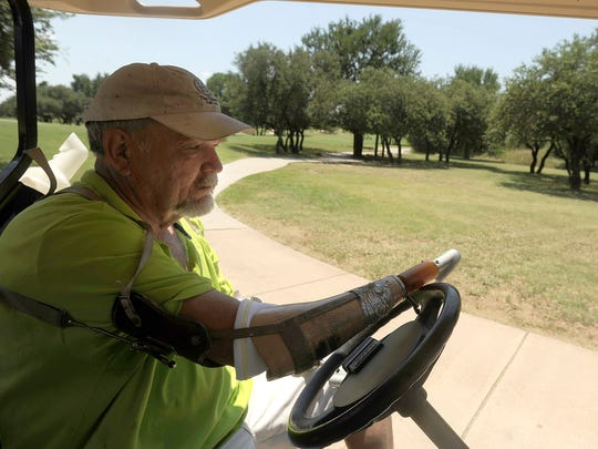 Steve Gandy, from Van, drives his cart between holes during a practice round for the Southwest Amputee Golf Association 2017 Regional Championships on Friday, June 23, 2017, at the Hideout Gold Club at Lake Brownwood.