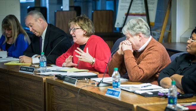 School board member Debbie Feick attends a meeting Tuesday, March 28, 2017.