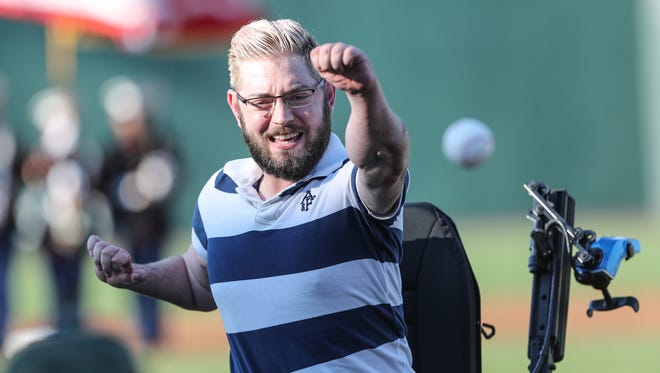 Marine Sgt. John Peck throws out the first pitch during Military Appreciation Night at Palisades Credit Union Park in Pomona prior to the Rockland Boulder's game against Trois-Rivieres Aigles on Saturday, June 30, 2018.  Peck, a Marine who lost all four limbs to an explosion in Afghanistan in 2010 is the first to have double-arm transplant.