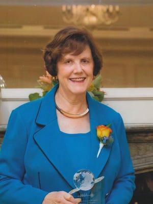 Dr. Carolyn Huntoon is shown receiving Lifetime Achievement Award from Women in Aerospace in 2014.