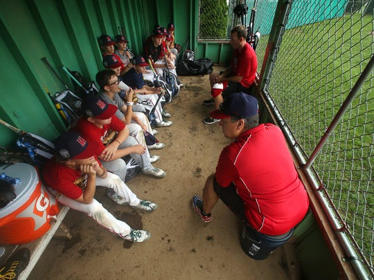 Manager Robert Grano has a heart to heart with his Mid-Atlantic Region champ Holbrook Little League in preparation for the next game vs.  Great Lakes Region Champion, Grosse Pointe Woods-Shores Little League of Grosse Pointe, Mich. August 18, 2016, South Williamsport, PA.