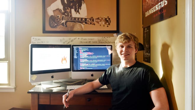 York Suburban senior Nick Pitoniak sits next to the computer in the bedroom of his home in Spring Garden Township. Pitoniak, 17, developed an app called Mutter Mail which deletes users' messages after 30 seconds.