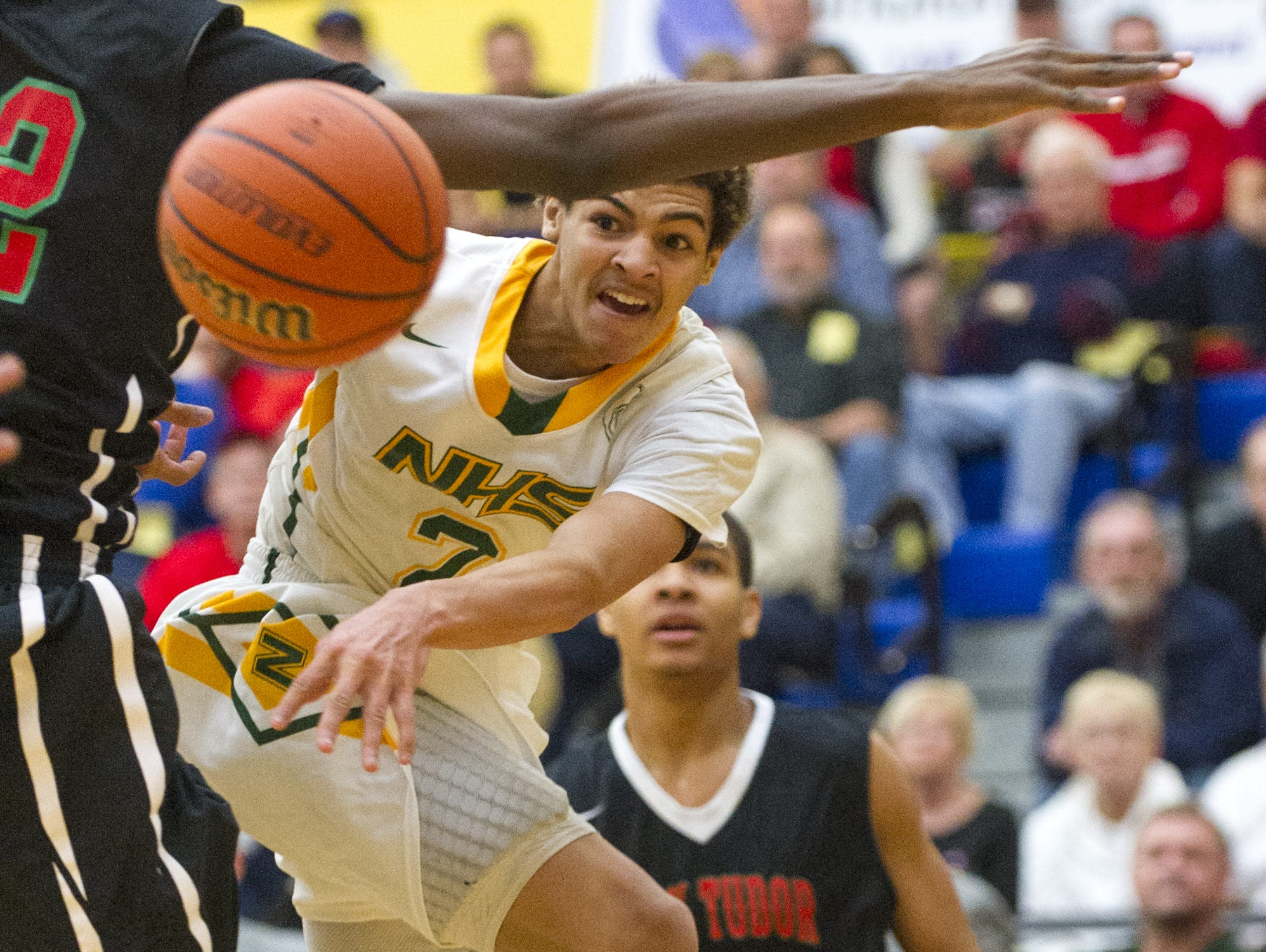 Northeastern High School sophomore Tyler Smith (2) fires off a pass after having his route to the basket blocked by Park Tudor High School sophomore Jaren Jackson, Jr. (32) during the first half of action. Greenfield-Central High School hosted the IHSAA Regional Boy's 2A Basketball tournament Saturday, March 14, 2015.