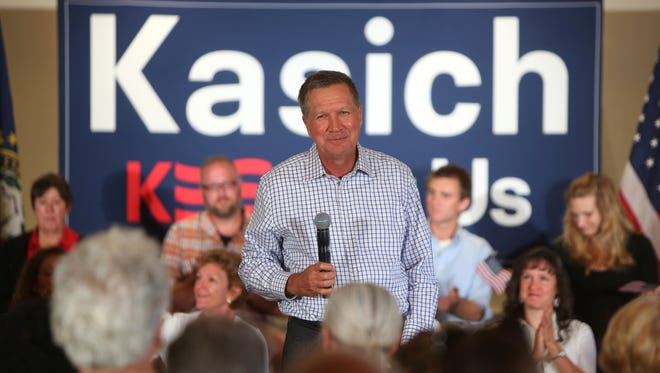 John Kasich, Ohio Governor and Republican presidential candidate, speaks to a crowd at a town hall style meeting at the Portsmouth Country Club while campaigning in New Hampshire on Wednesday, July 22.