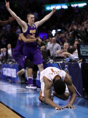 Isaiah Taylor #1 of the Texas Longhorns reacts after Paul Jesperson  of the Northern Iowa Panthers hit a half court three pointer at the buzzer to win the game with a score of 75-72 during the first round of the 2016 NCAA Men's Basketball Tournament at Chesapeake Energy Arena.