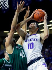 Kansas State's Isaiah Maurice (10) puts up a shot under pressure from Green Bay's Kenneth Lowe (45) during the first half of an NCAA college basketball game Wednesday, Nov. 30, 2016, in Manhattan, Kan. (AP Photo/Charlie Riedel)