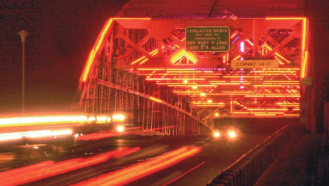 The Texas Street bridge glows from the neon lights installed in 1994 in this 2001 file photo.